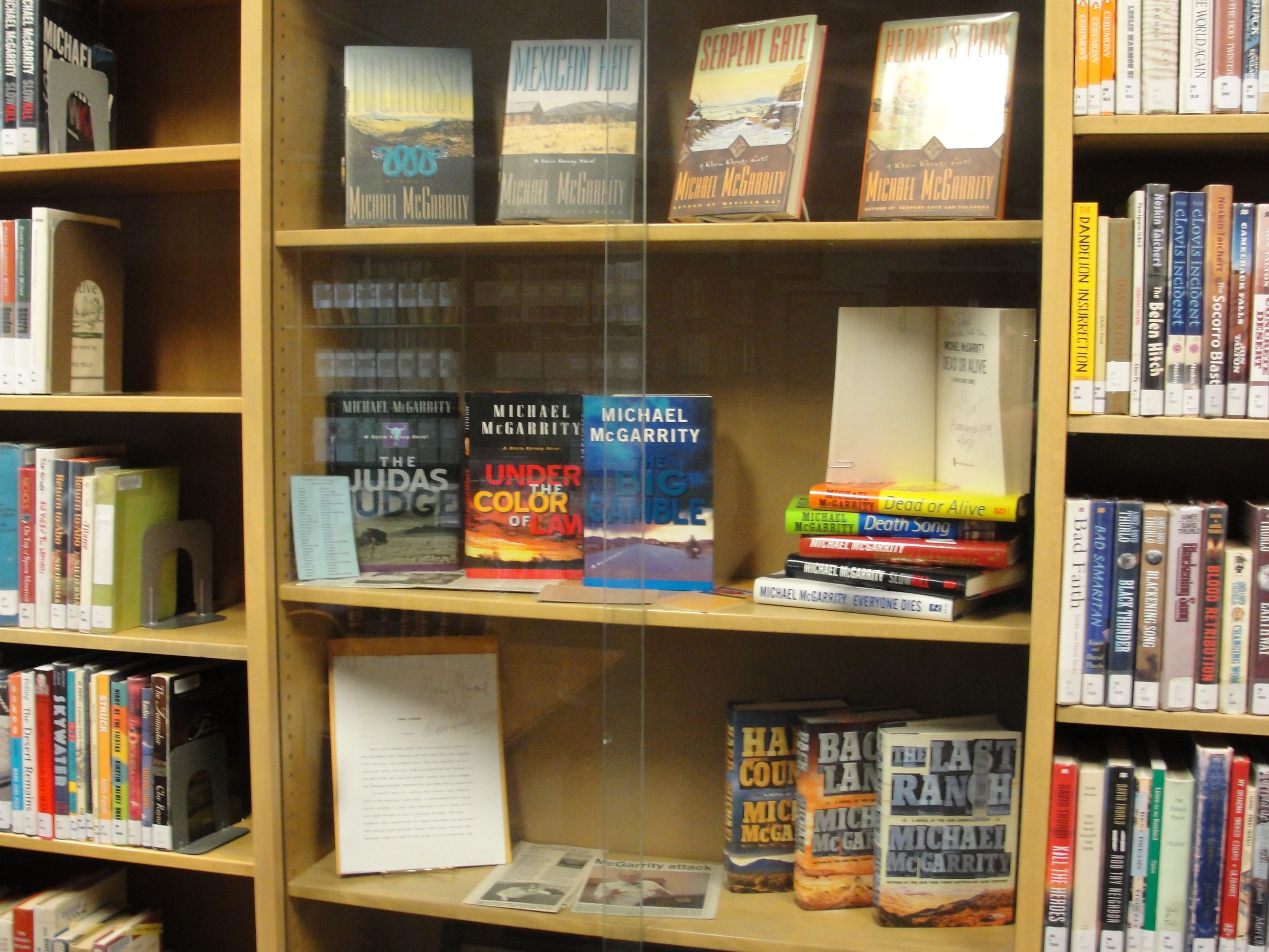 Michael McGarrity books on display in the library.